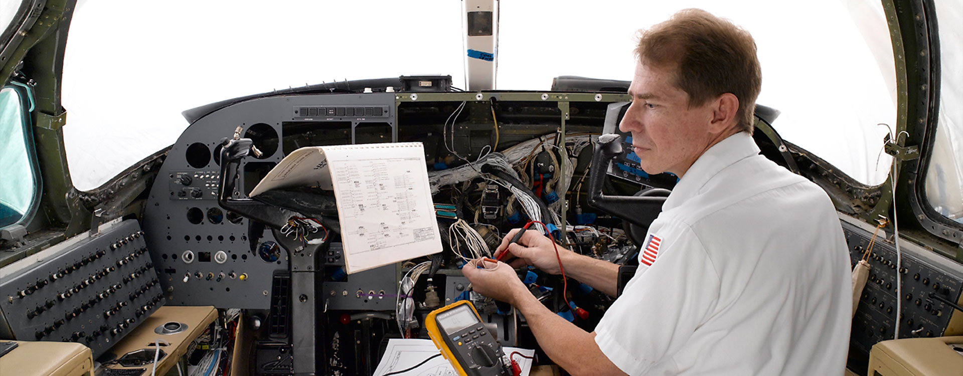 Technician installing avionics corporate jet