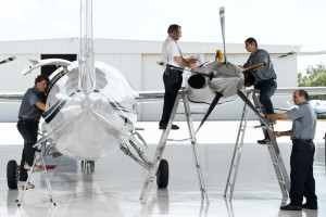Technicians working on Piaggio